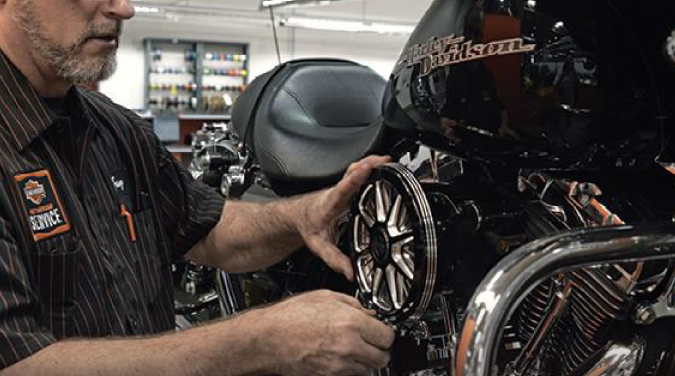 Vehicle Technician working on a motorcycle.