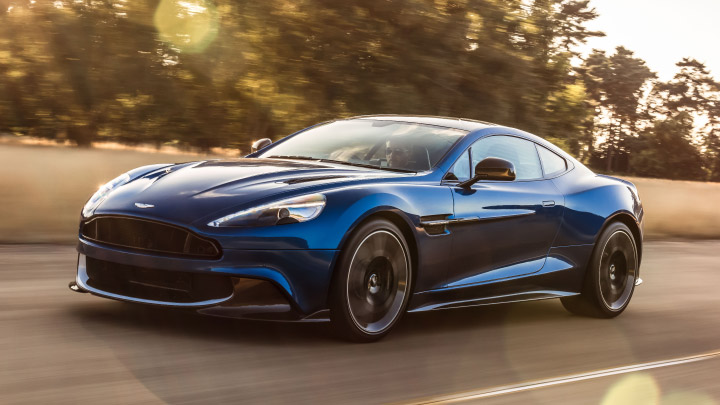 Aston Martin Vanquish S in blue driving on the road.