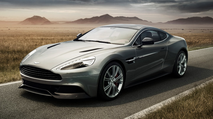 Aston Martin Vanquish in grey on the road.