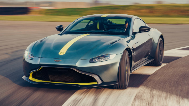 Aston Martin Vantage in green driving on the track.