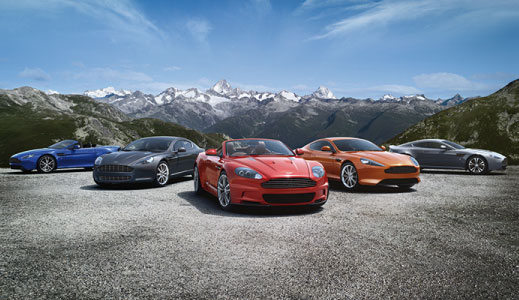 A variety of used Aston Martin's outside.