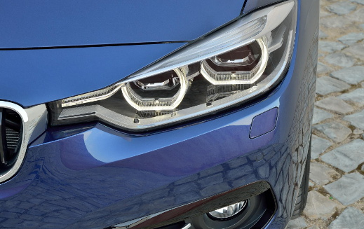 Blue BMW 3 Series headlights.
