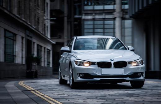 White BMW 3 Series parked.