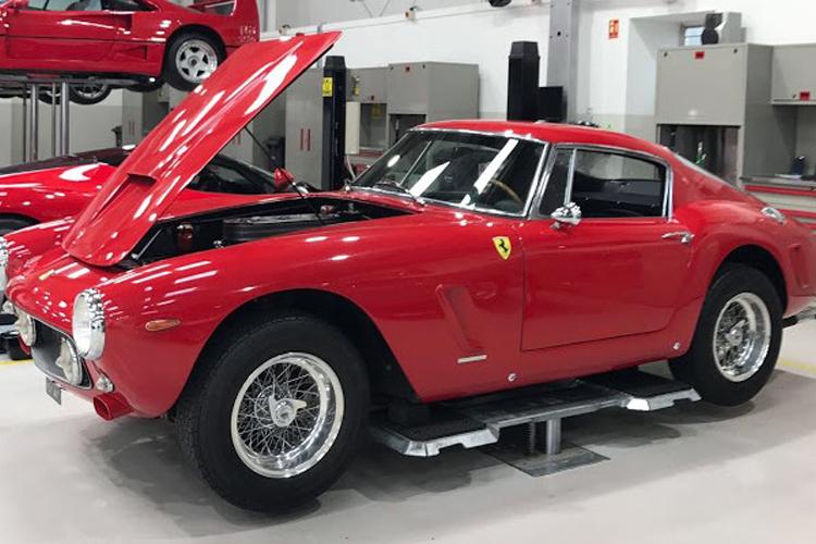 Red 1962 Ferrari 250 SWB with the bonnet open.