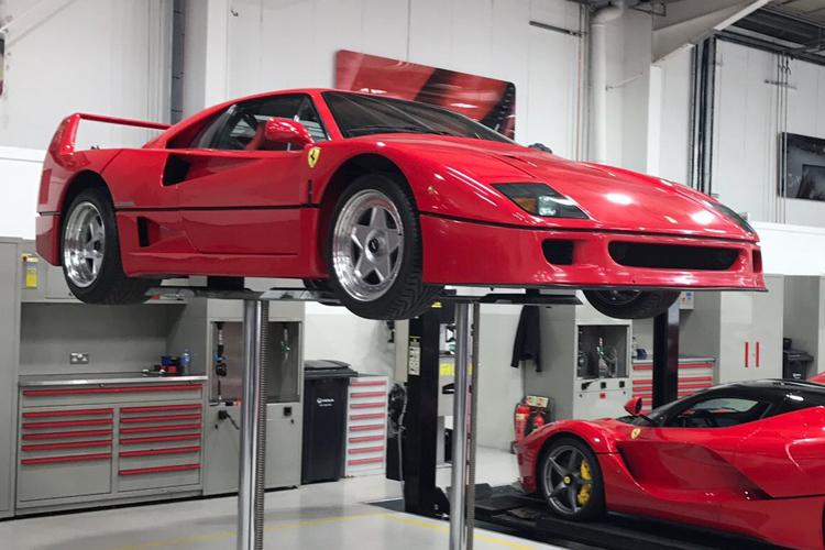 Red 1987 Ferrari F40 in the workshop.