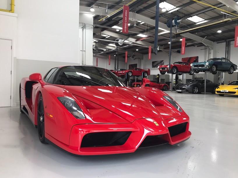 Red 2002 Ferrari Enzo in the workshop.
