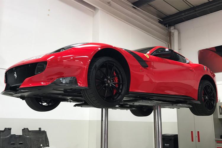 Red 2016 Ferrari F12tdf in the workshop.
