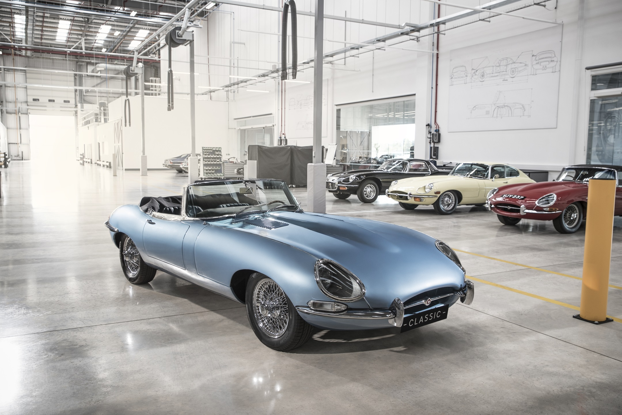 Blue Jaguar E-Type Zero in garage.