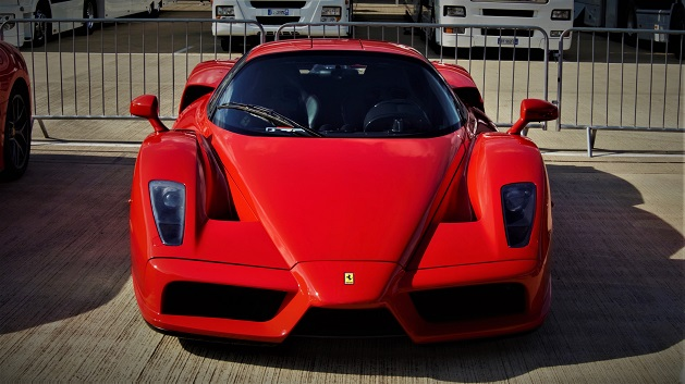 Red Ferrari Enzo parked.
