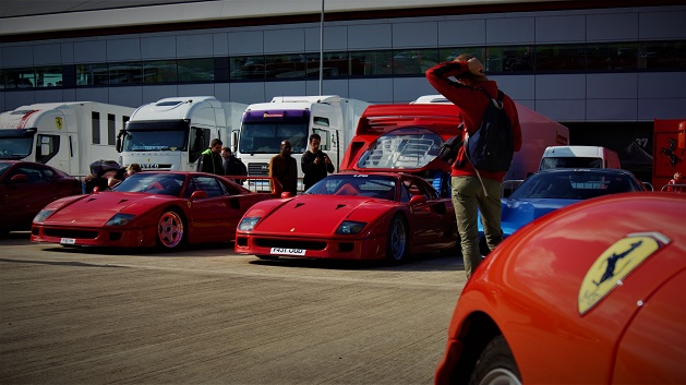 Two Ferrari F40s parked.