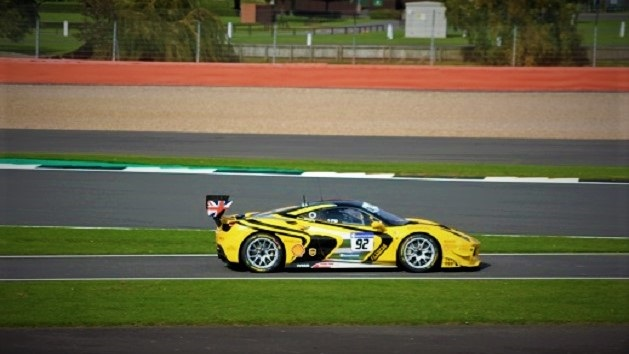 Yellow Saleen S7 racing on the Silverstone track.