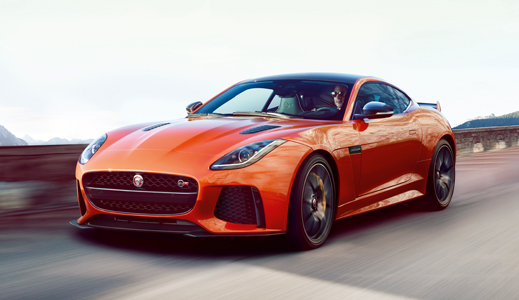 Orange Jaguar F-Type SVR (2016) driving on the road.
