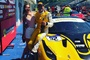 Sam Smeeth sat on a yellow Ferrari.