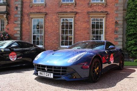 Blue Ferrari F12 Berlinetta parked up.