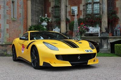 Yellow Ferrari F12tdf parked.