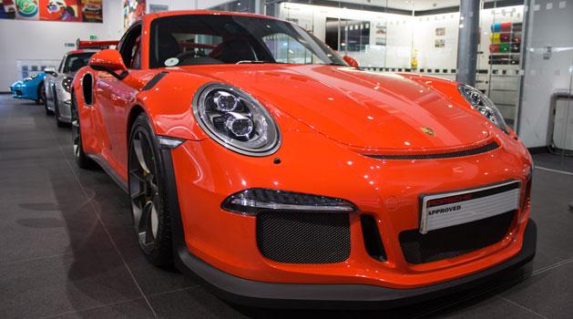 Red Porsche 911 GT3 RS in the Wolverhampton Porsche centre showroom.