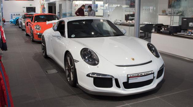 White Porsche 911 GT3 in the Wolverhampton Porsche centre showroom.