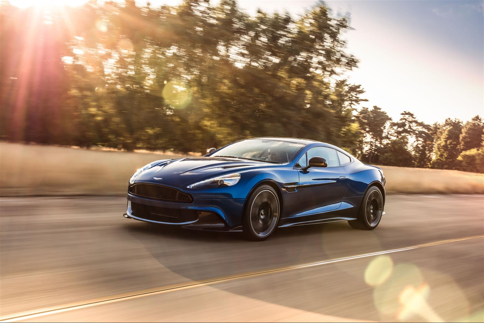 Aston Martin Vanquish S driving on the road.