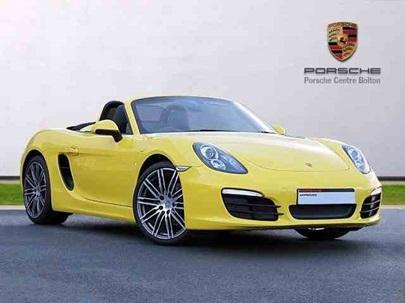 Yellow Porsche Boxster.
