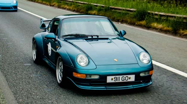 Porsche 911 (993) GT2 driving on the road.