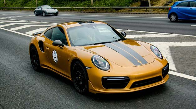 Porsche 911 Turbo S Exclusive Series driving on the road.