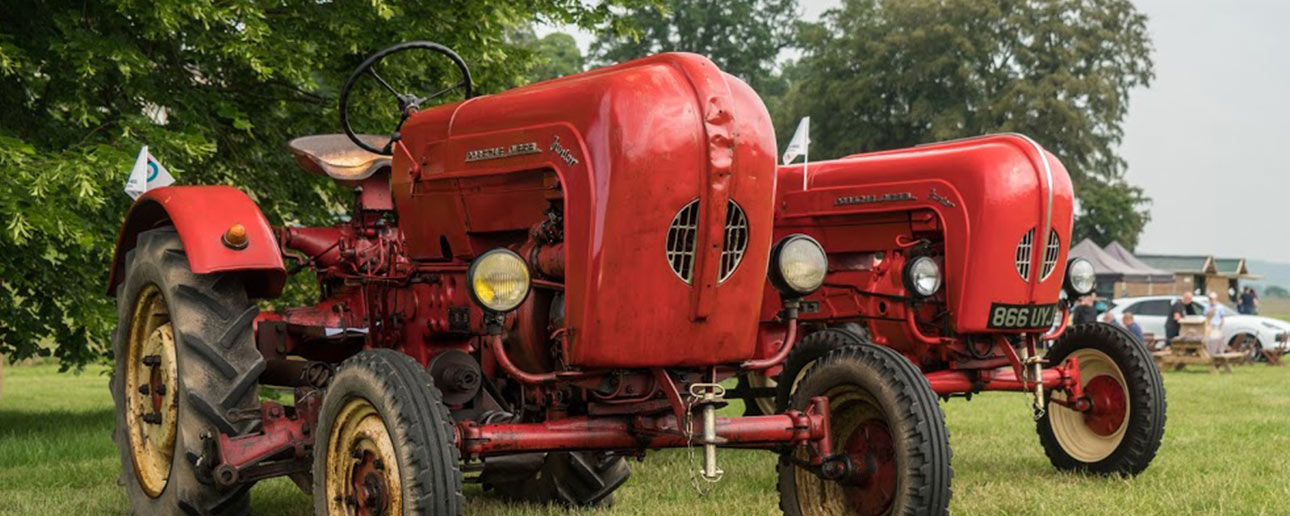 Two 1930 Porsche diesel tractors in red.