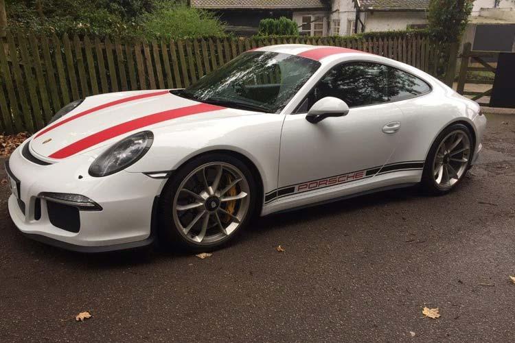 Porsche 911 R in white with red stripes.