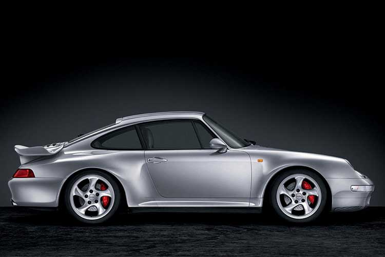Side view of a Porsche 993 Turbo in silver.