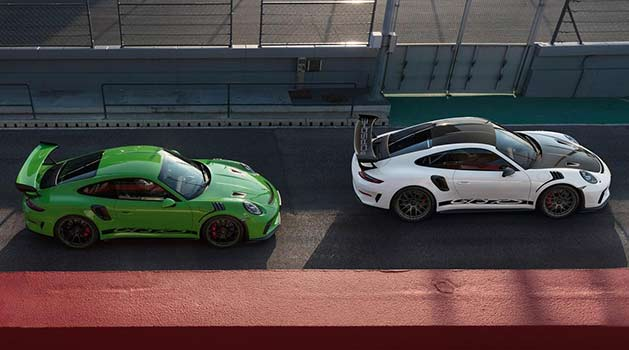 Two Porsche GT3 RS in green and white.