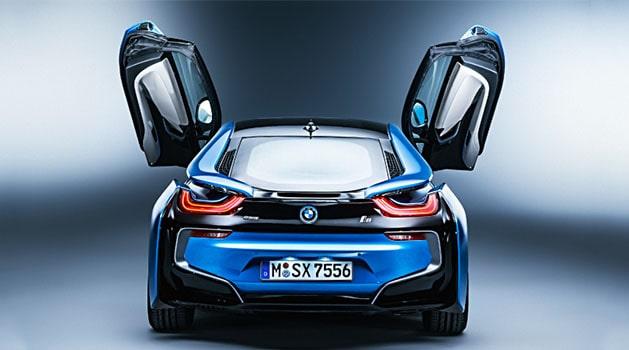 Blue BMW i8 open doors front view.