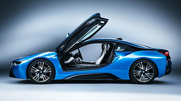 Blue BMW i8 open doors side view.