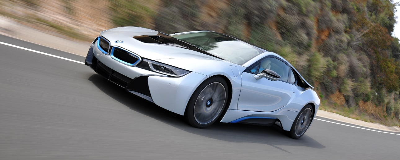 White BMW i8 on the road.