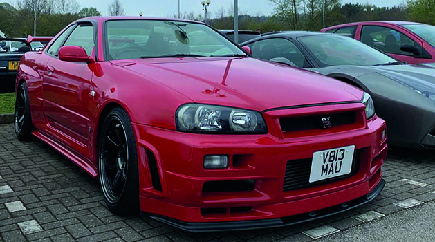 Red Nissan Skyline R34 at Pendragon's Car Cafe, Nottinghamshire.