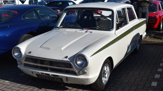 White Ford Cortina Lotus (Lotus Cortina) in the Pendragon PLC car park for Car Cafe.