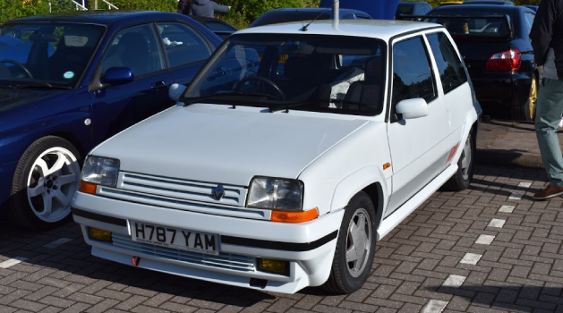 White Renault 5 GT Turbo in Pendragon PLC car park for Car Cafe.