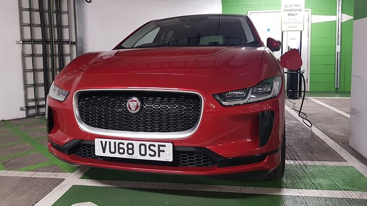 Red Jaguar I PACE using charging point