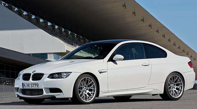 White BMW 'E92' M3 (2007) parked up.