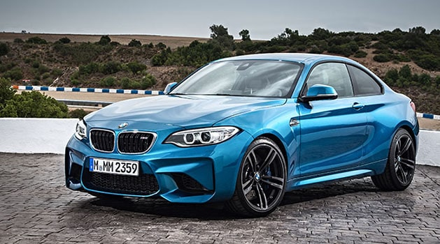 Blue BMW 'F87' M2 (2016) parked up.