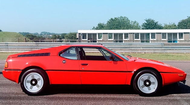 Red BMW M1 (1978) parked up.