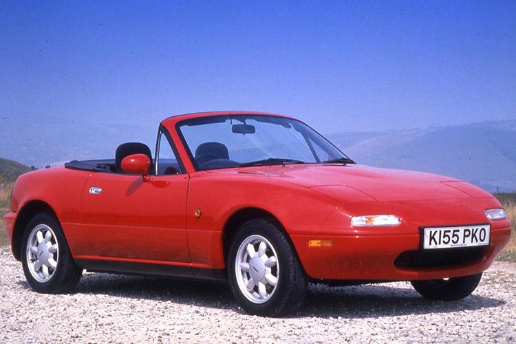 Mazda Miata in red.
