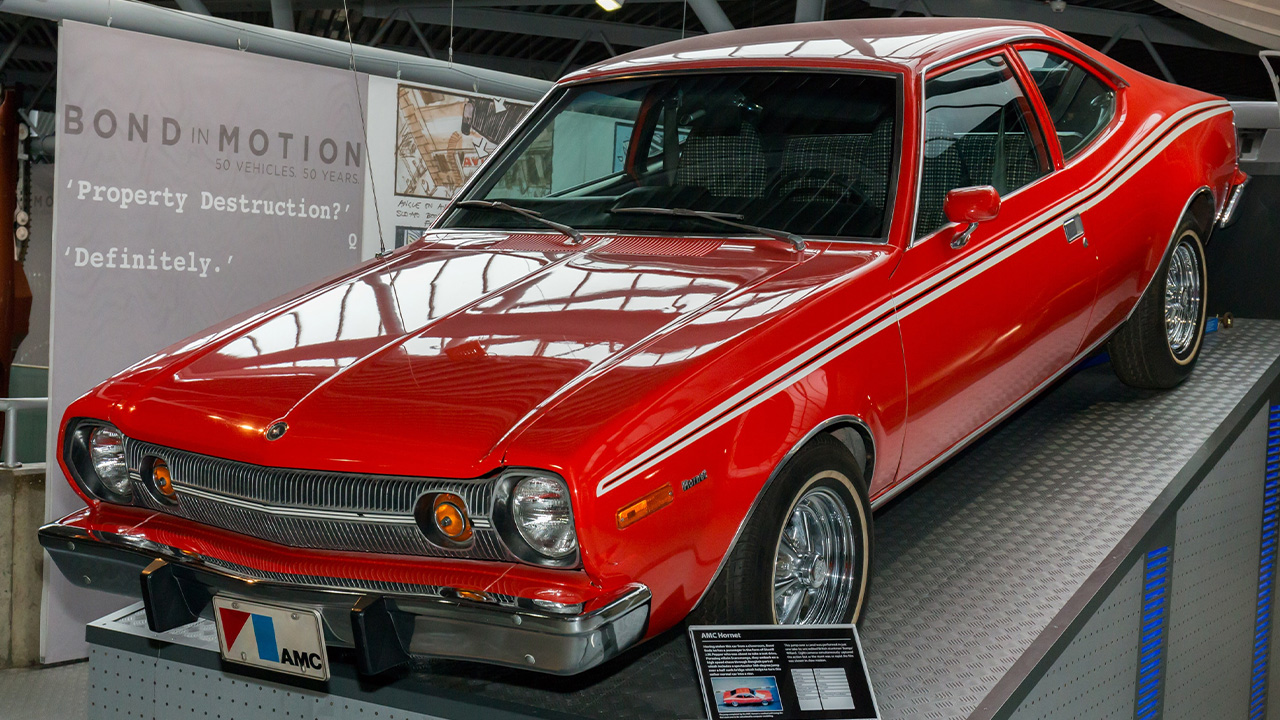 Red AMC Hornet, parked on ramps