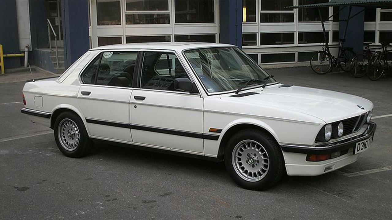 White BMW 5 Series, parked