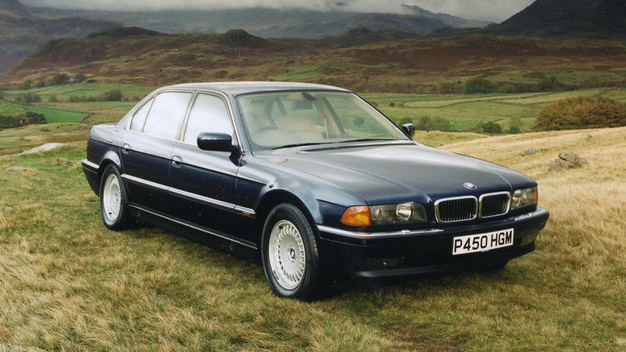 Blue BMW 7 Series, parked in countryside