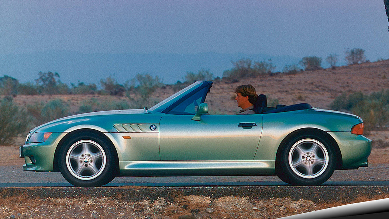 Green BMW Z3, side profile with roof down