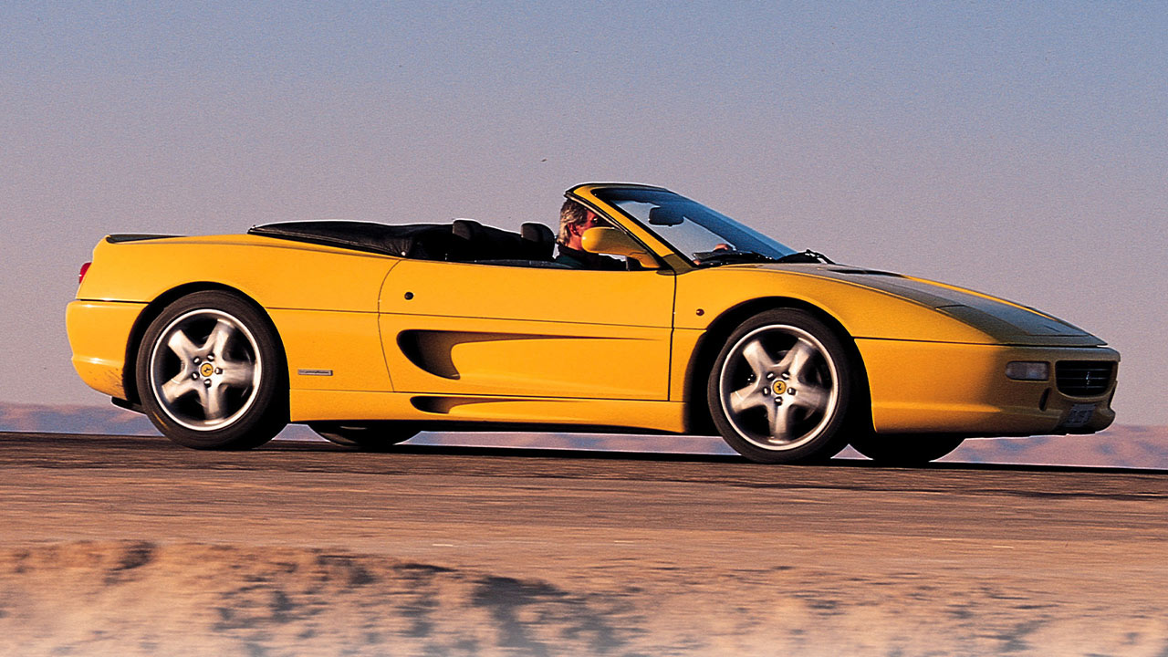 Yellow Ferrari F355 Spider, driving