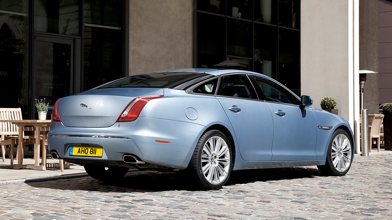 Blue Jaguar XJ, parked on cobbles
