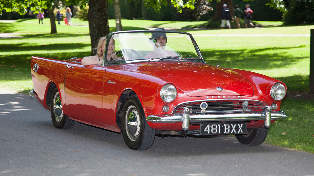 Red Sunbeam Alpine, driving with the roof down