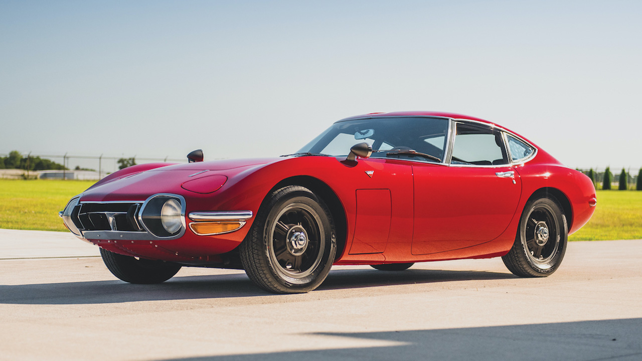 Red Toyota 2000GT, driving on a runway