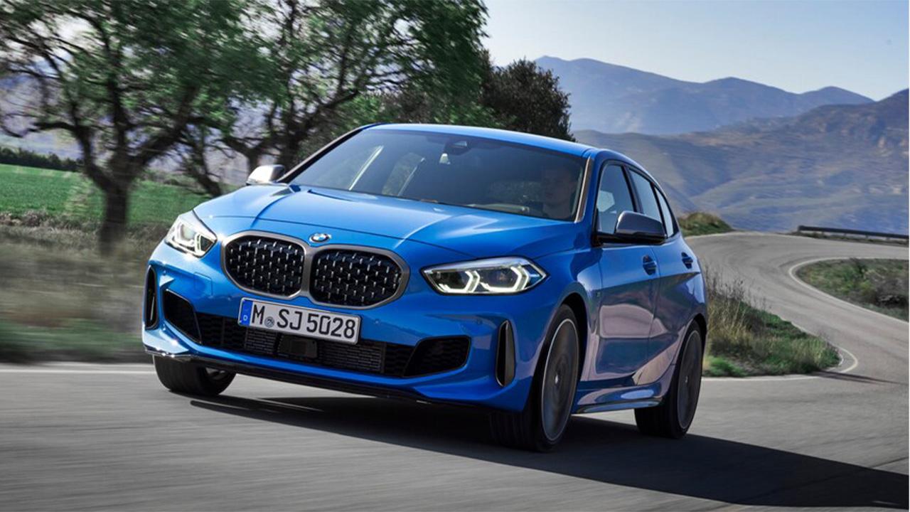 Blue BMW 1 Series, driving