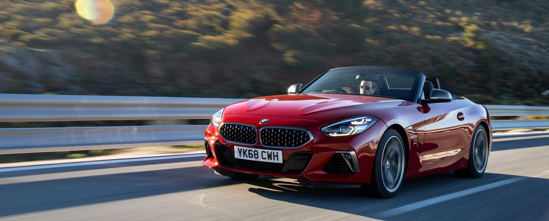 red bmw z4, driving